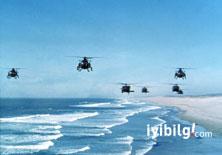 İran gemisi ABD helikopterine silah doğrulttu